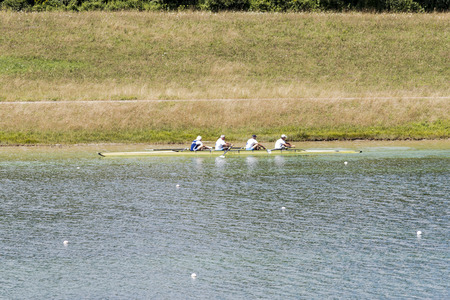 Rowers in rowing boats on the tranquil lake Editorial