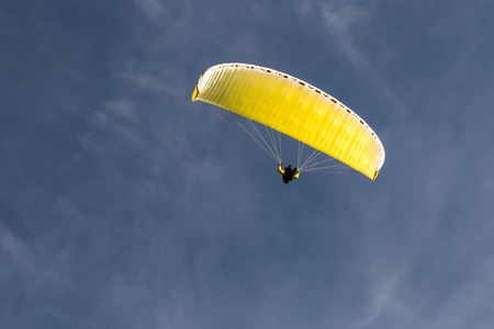 parachute jump: Paragliding in the blue sky with clouds