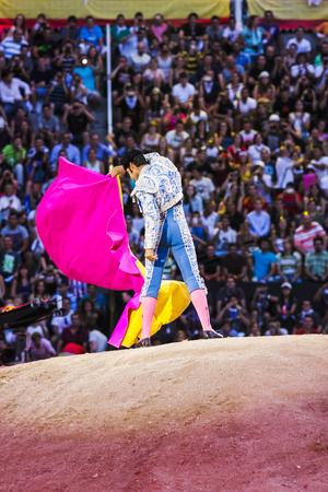 bullfighter making movements Editorial