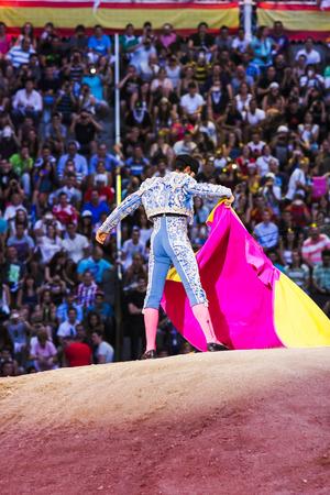 Bullfighter making movements Stock Photo