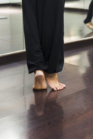 A Ballerina dancing, closeup on legs and shoes.