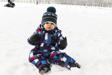 A baby on snow in the forest