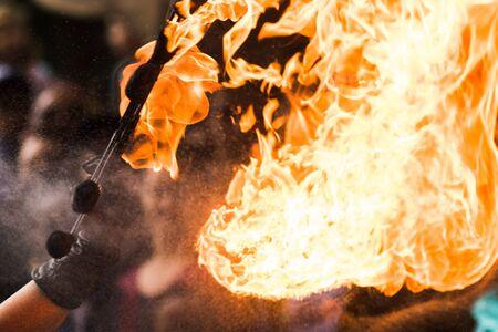 A Fire show artist breathe fire in the dark jamp Stock fotó