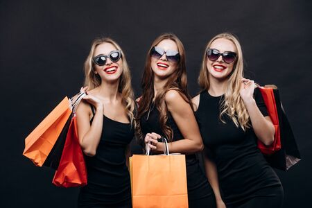Girls Posing With Purchases After Successful Friday Shopping