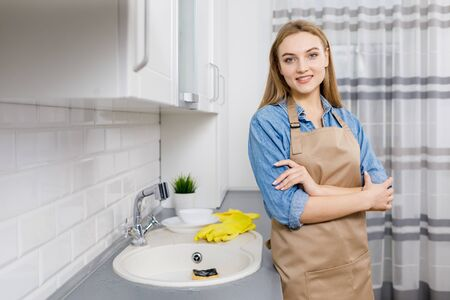 Smiling Woman Posing as the Dishes Are Washed
