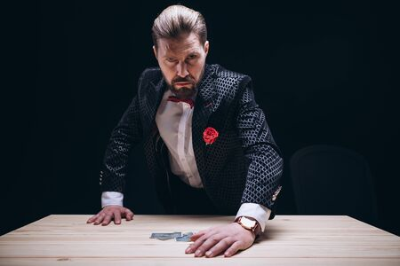 Angry Male Gambler in Suit Getting Up From Table