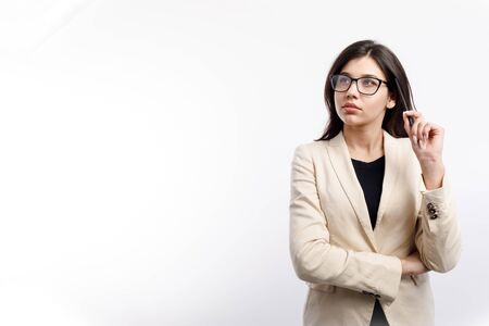 Thoughtful Female Office Clerk in Glasses Looking Upwards