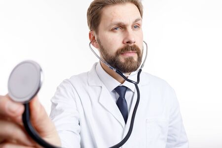 A Attentive Bearded Doctor in White Auscultating