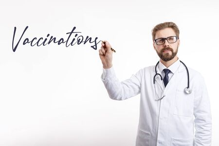 Male Physician Writing the Vaccination Word in Air