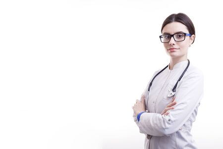 Young Smiling Female Doctor in Scrubs With Stethoscope Posing