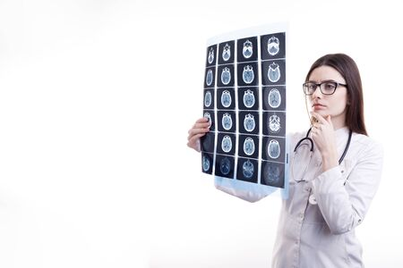 Pensive Female Physician Examining Patients Brain Tomography Film