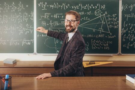 Cheerful Bearded Professor in Glasses Explaining the Formulas