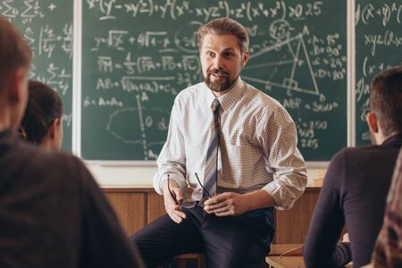 Cheerful Professor Having a Casual Informal Conversation With Students