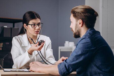 Medical Employee is Surprised by Patients Blood Pressure Standard-Bild