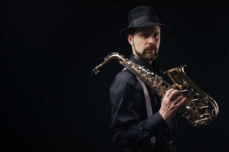 Man with saxophone on shoulder