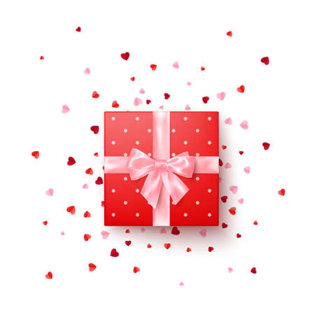 Realistic red gift box with pink silk bow decorated confetti top view. Vector illustration