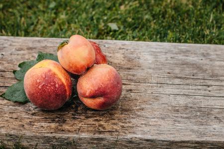 Fresh peaches, Peach close up fruit background, peach on wood background,sweet peaches, group of peaches,sliced peaches, peach slices