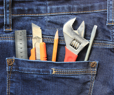 maintainer: Work tools in jeans pocket