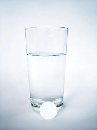 Tablet and glass of water Stock Photo - 3192736