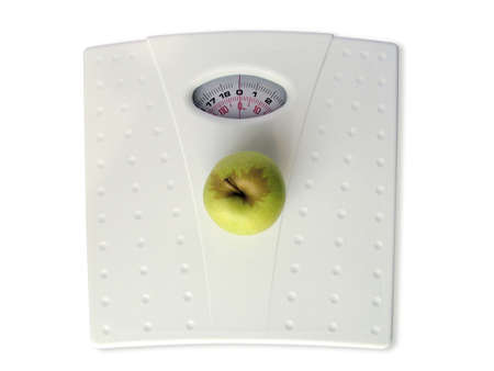 Apple on scales LANG_EVOIMAGES