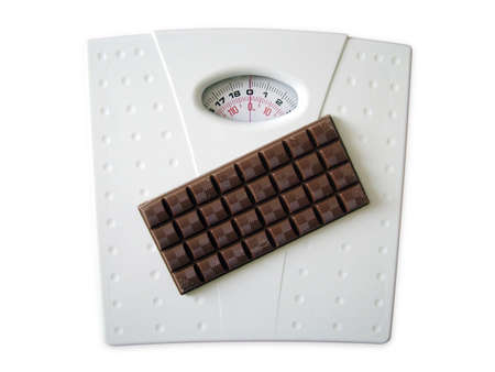 Chocolate on scales Stock Photo - 3192787