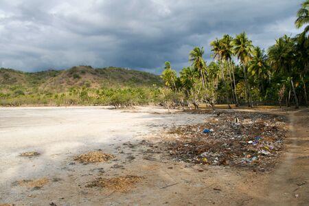 Pollution on remote tropical island beach