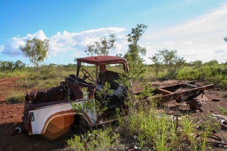 Vintage rusty car wreck in Australian outback Stock Photo