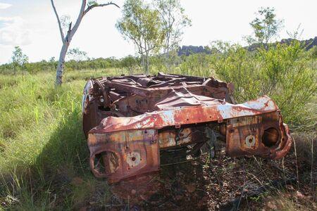 Rusty car wreck in Australian outback