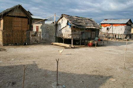 Wooden houses on mudfats in remote fishing village