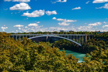 Niagara Falls, Ontario, Canada - August 29, 2019: Niagara Falls International Rainbow Bridge crossing between Canada and the United States
