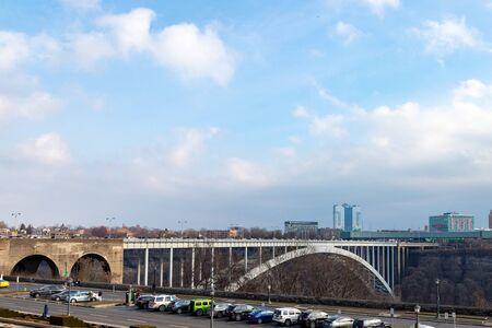 Niagara Falls, Ontario, Canada, December 27, 2019: Cars lining up on Rainbow Bridge for border crossing between Canada and USA