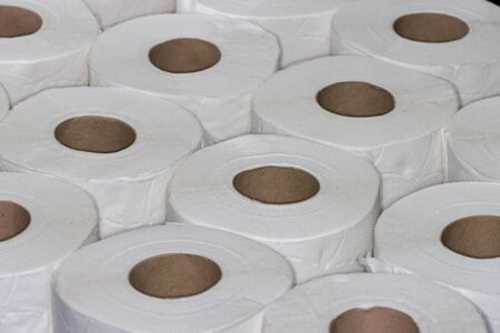 Layer of white toilet paper rolls seen from angle above filling frame Stock Photo