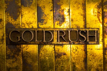 Gold Rush text formed with real authentic typeset letters on vintage textured silver grunge copper and gold background