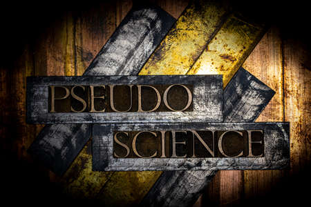 Pseudoscience text formed with real authentic typeset letters on vintage textured silver grunge copper and gold background