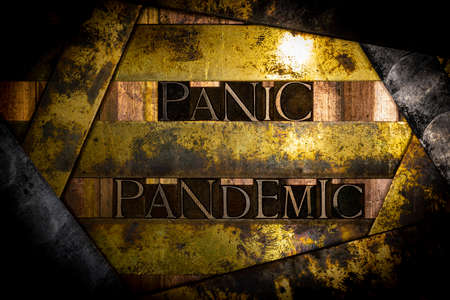 Panic Pandemic text formed by real authentic typeset letters on vintage textured grunge copper and gold background