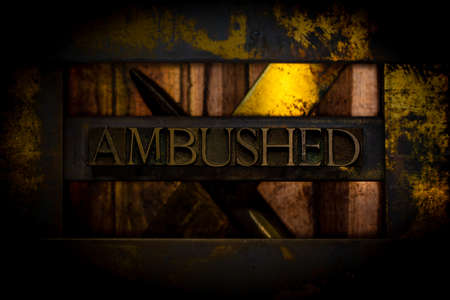 Ambushed text formed with real authentic typeset letters on vintage textured grunge darkened copper background Stock fotó