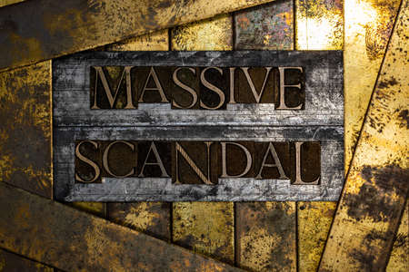 Massive Scandal text message on textured grunge copper and vintage gold background