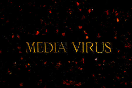 Media Virus text in neon letters on black background with red virus particles 스톡 콘텐츠
