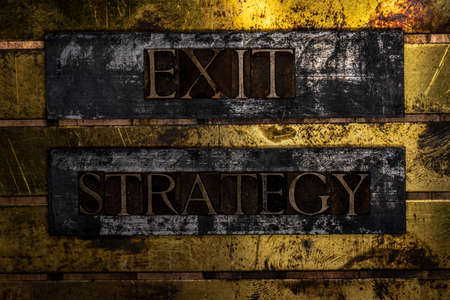 Exit Strategy text message on textured grunge copper and vintage gold background