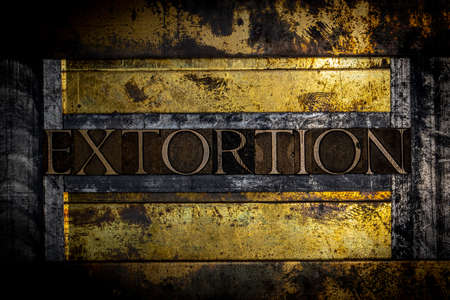 Extortion text message on textured grunge copper and vintage gold background