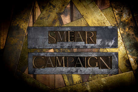Smear Campaign text message on vintage textured grunge copper and gold background