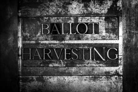 Ballot Harvesting text message on textured grunge metal monochrome background