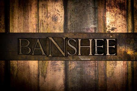Banshee text message on vintage textured grunge bronze background