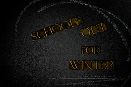 School's Out for Winter text on blackboard with white chalk lines