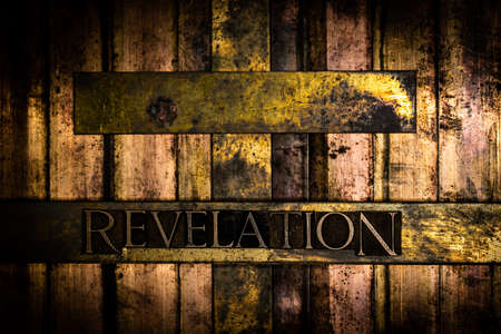 Revelation text with cross on textured grunge copper and vintage gold background Imagens