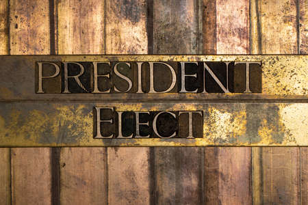 President Elect text message on textured grunge copper and vintage gold background