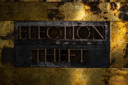 Election Theft text message on textured grunge copper and vintage gold background Stockfoto