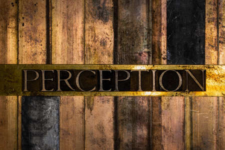 Perception text message on vintage textured grunge copper and bronze background Stockfoto