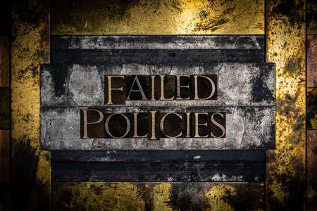 Failed Policies text on textured lead over grunge copper and vintage gold background Banco de Imagens
