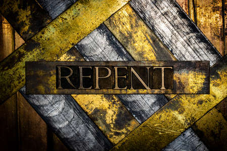 Repent text on grunge silver with textured copper and gold background